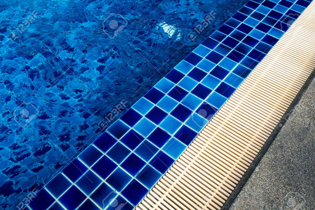 Blue Ceramic Tile Flooring And Drainage Gutters Beside The Pool ...