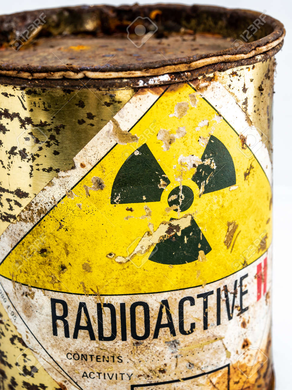 Radiation warning sign on transport index label stick on the rust and decay radioactive material container, Ionizing radiation hazard symbol as background - 167262684