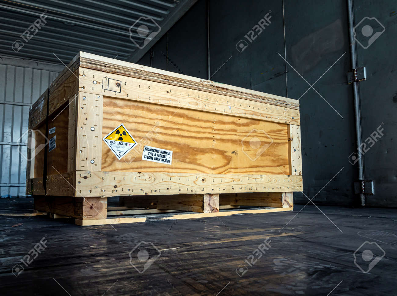 Radiation warning sign on the Hazardous materials transport label Class 7 at the wooden box Type A standard package in the container of transport truck - 167262978