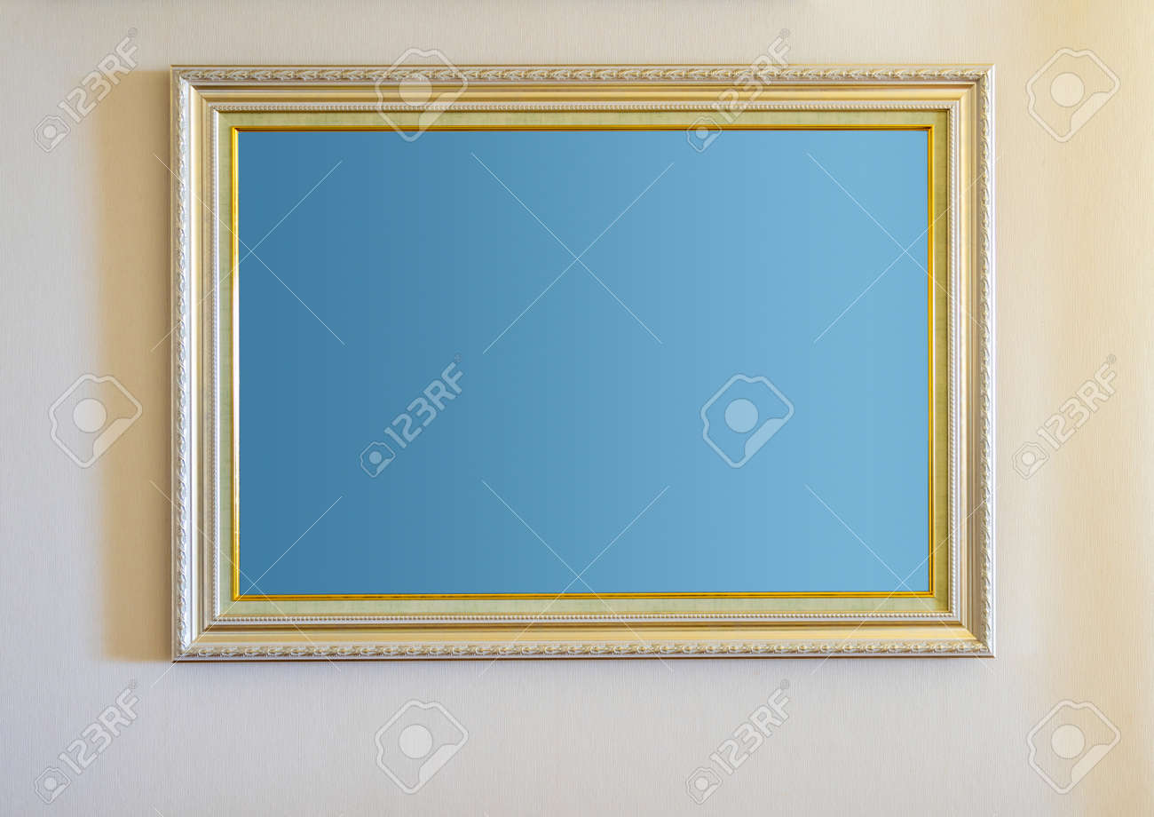 The blank ornate picture frame on the wall - 171431458