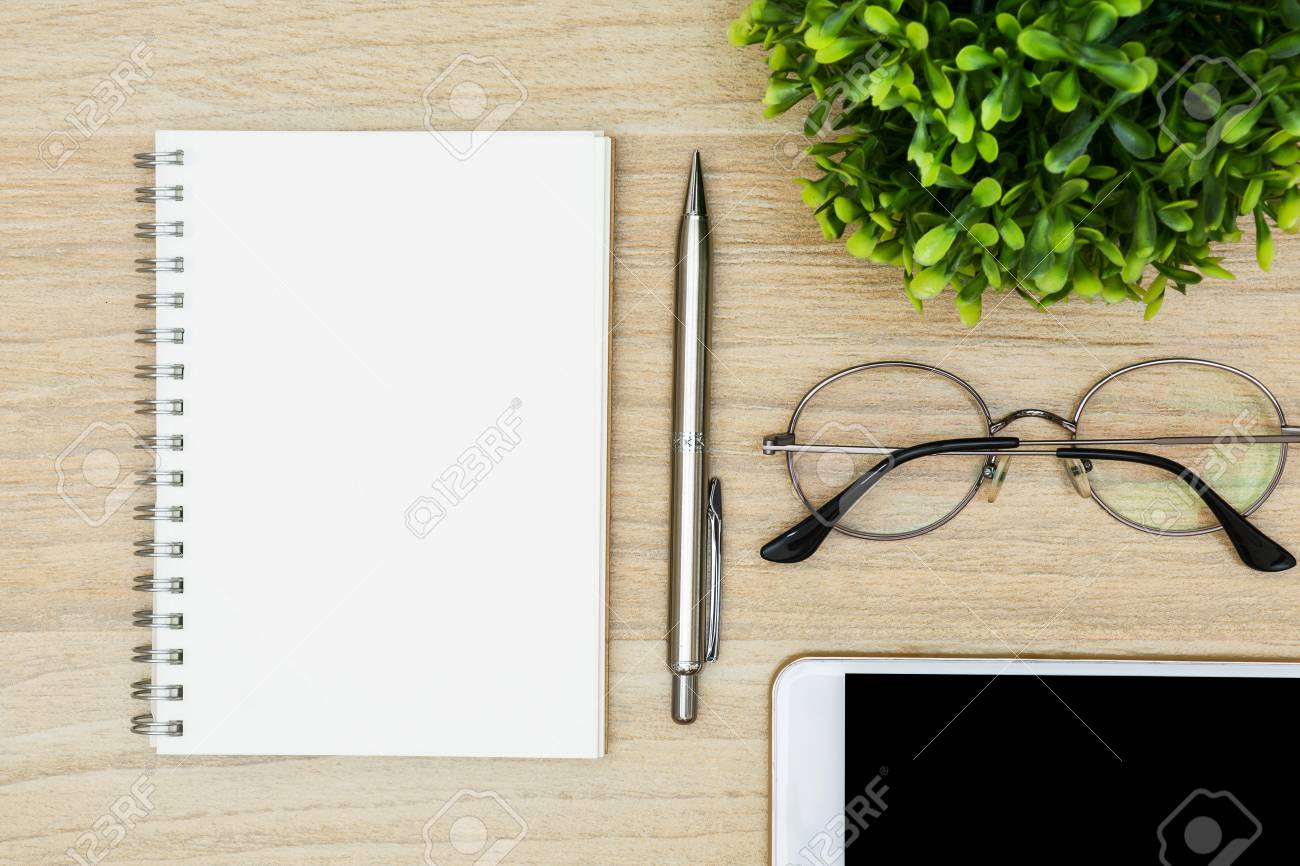 office table top view. Plain View Foto De Archivo  Notebook With Pen On Top Of Wood Office Desk Table Top  View Flat Lay And Office Table View