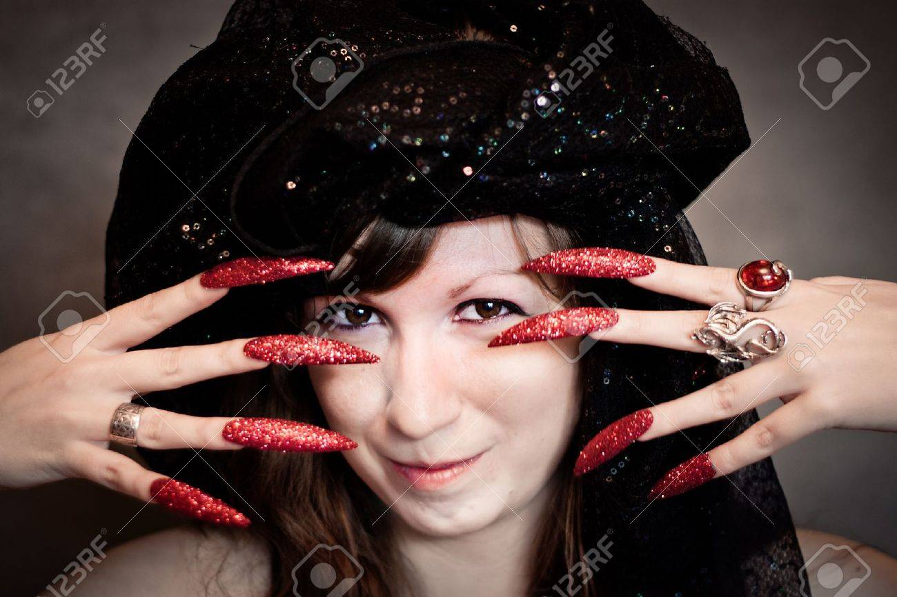 Pretty young witch with black turban and long nails Stock Photo - 10602940