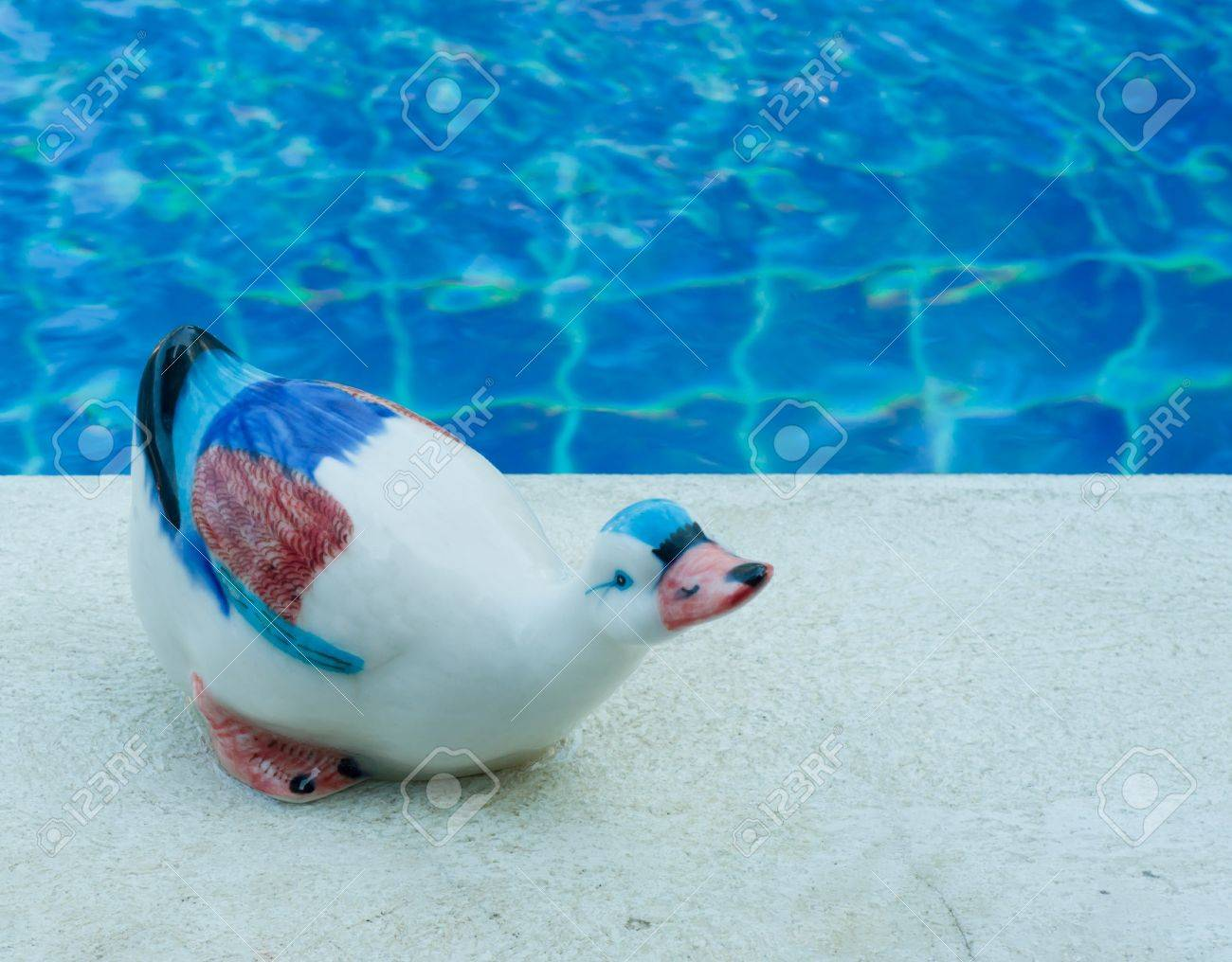 ceramic duck on swimming pool edge Stock Photo - 11709166