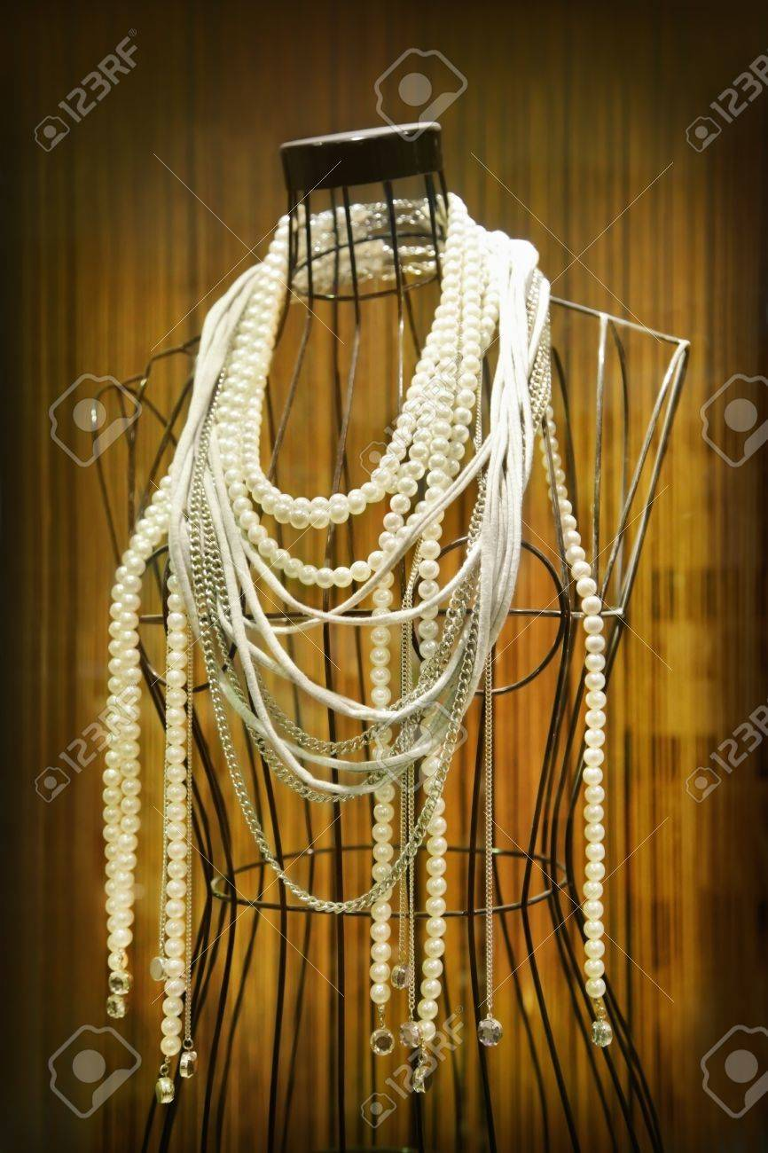 Mannequin with necklaces in store showcase Stock Photo - 9701640