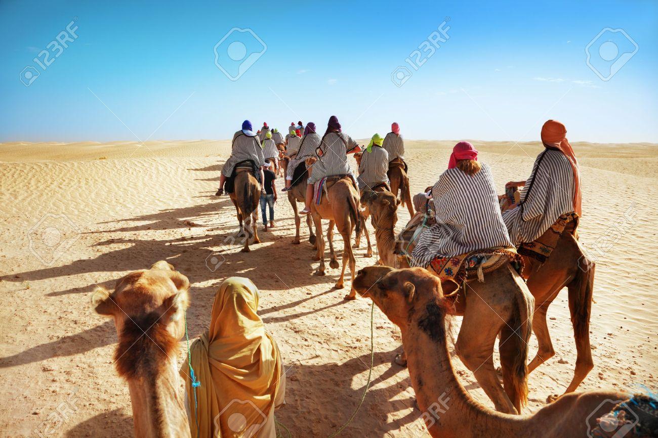 People in the Sahara desert - 15083420