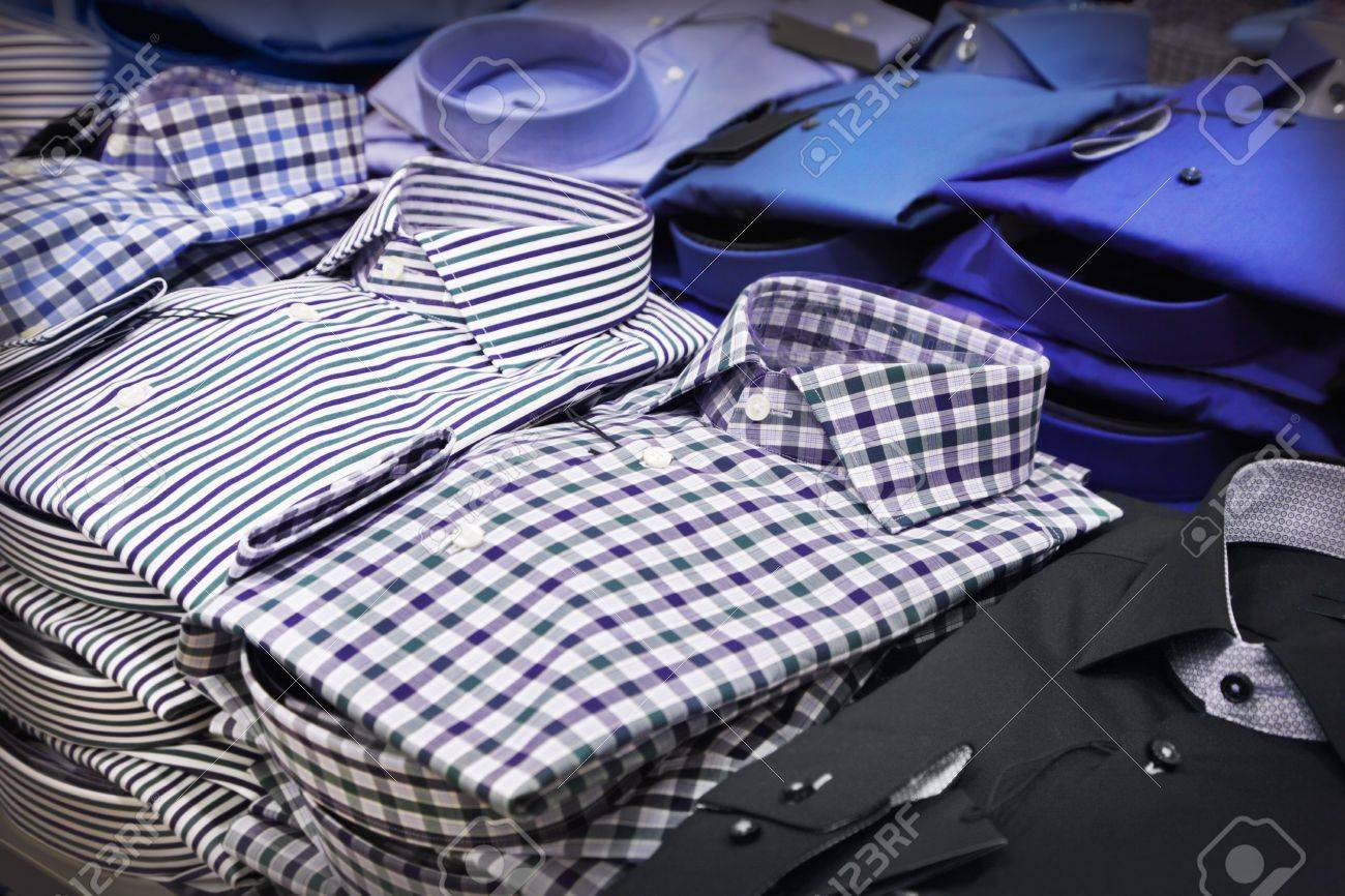 Different shirts in a shop - 19449546