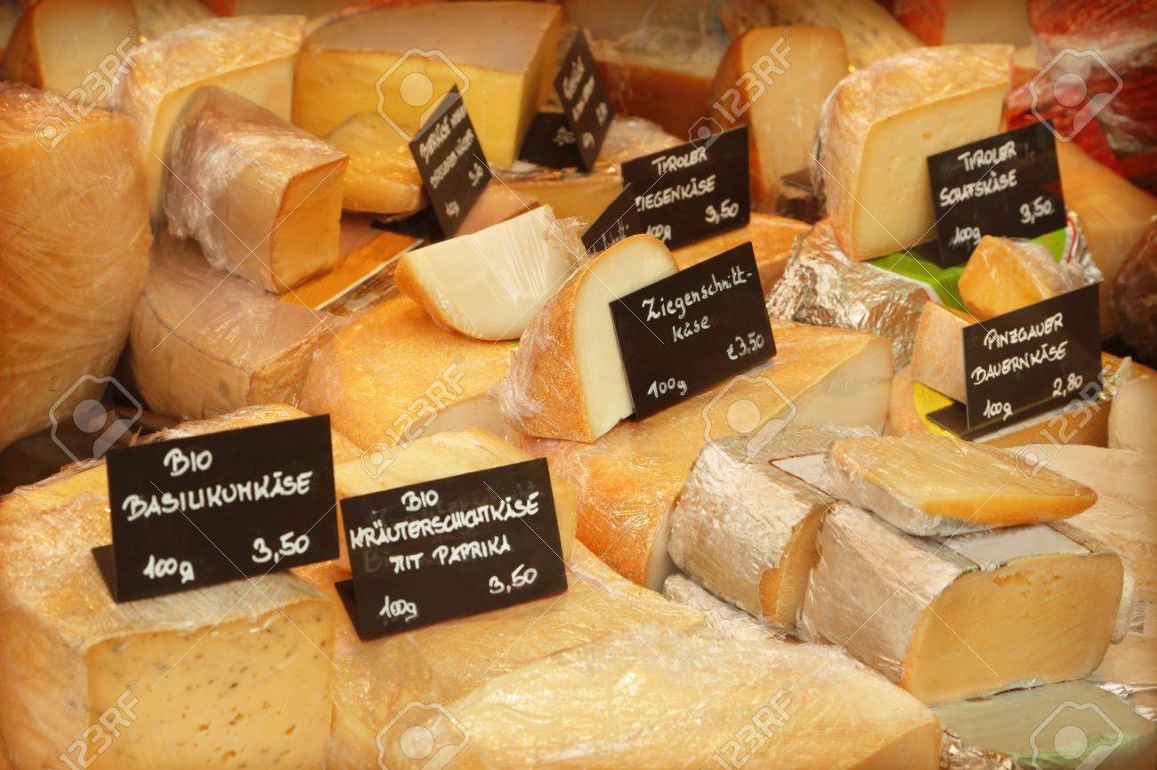 Different cheeses in a shop - 20014859