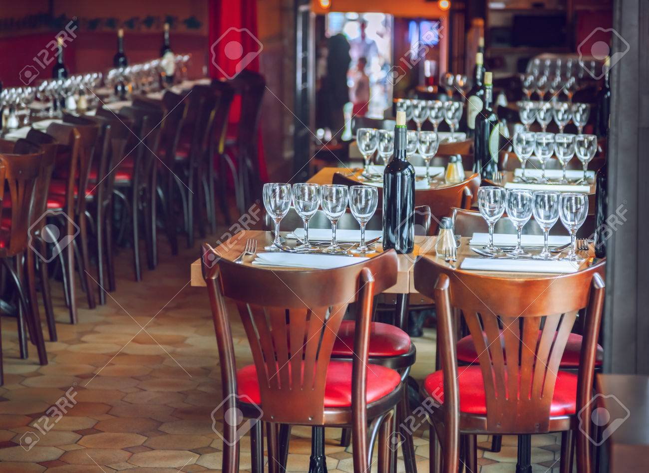 Traditional restaurant interior with tables and chairs - 46425131