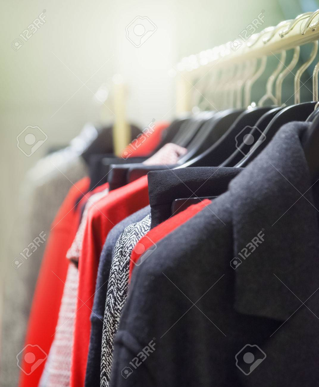 A row of clothes hanging on the rack - 46425138