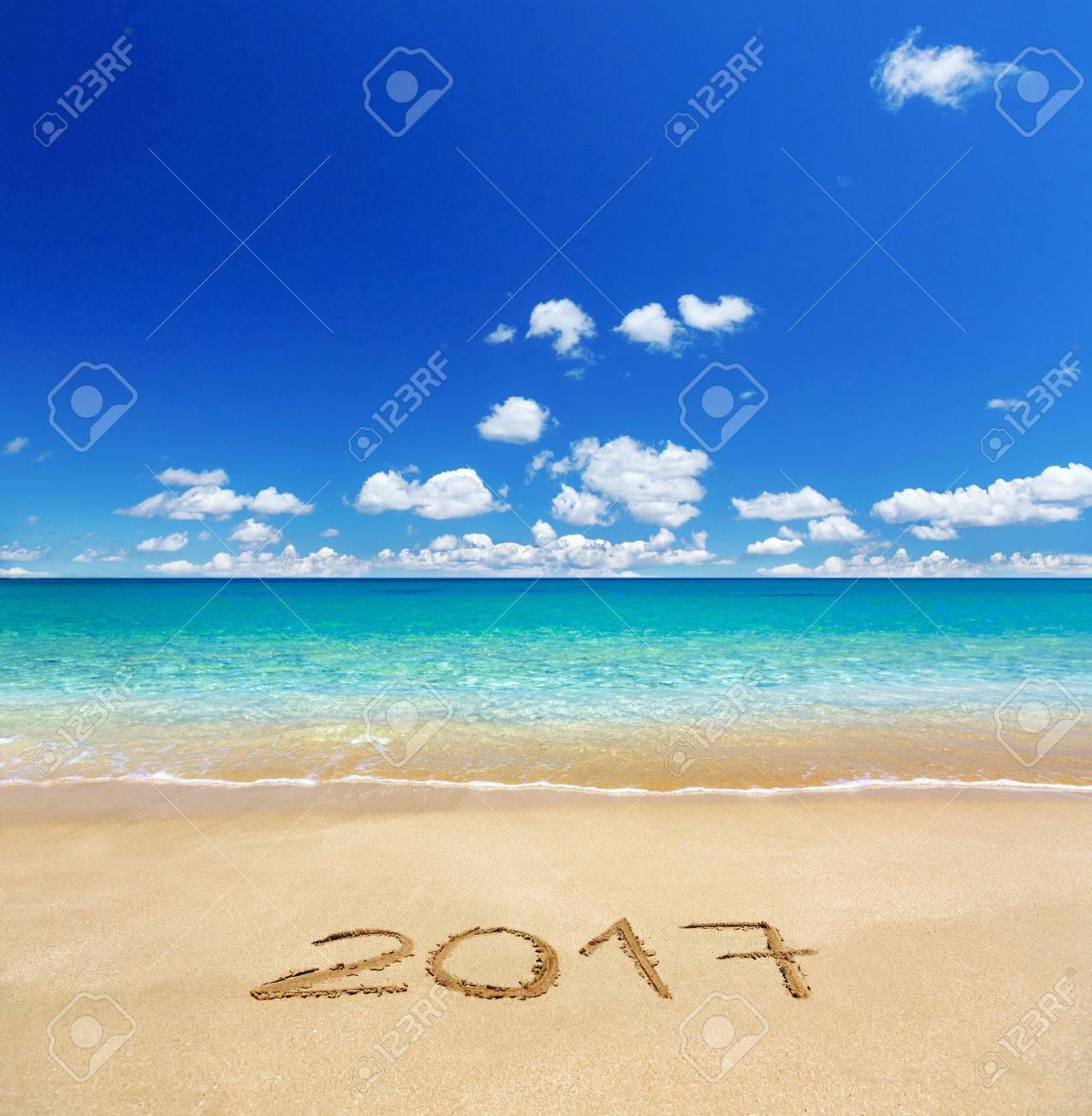 2017 written on sandy beach - 63676401