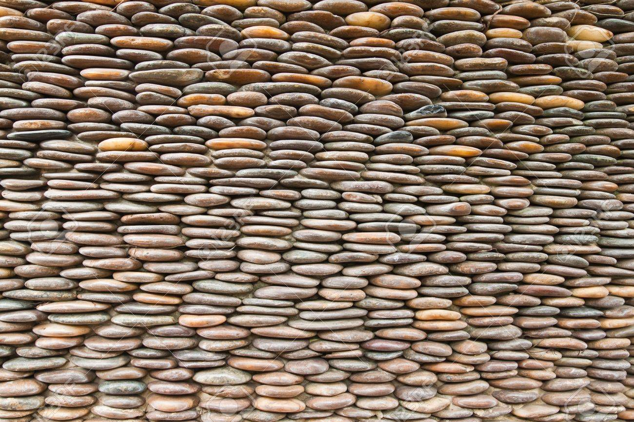 Close up of circle pebble wall,abstract background Stock Photo - 10371402