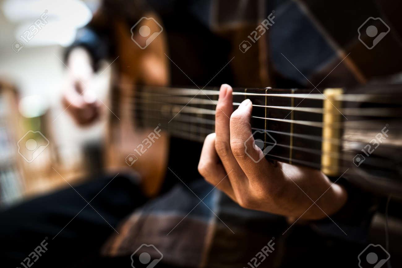 Hands of a guitar player - 158864255