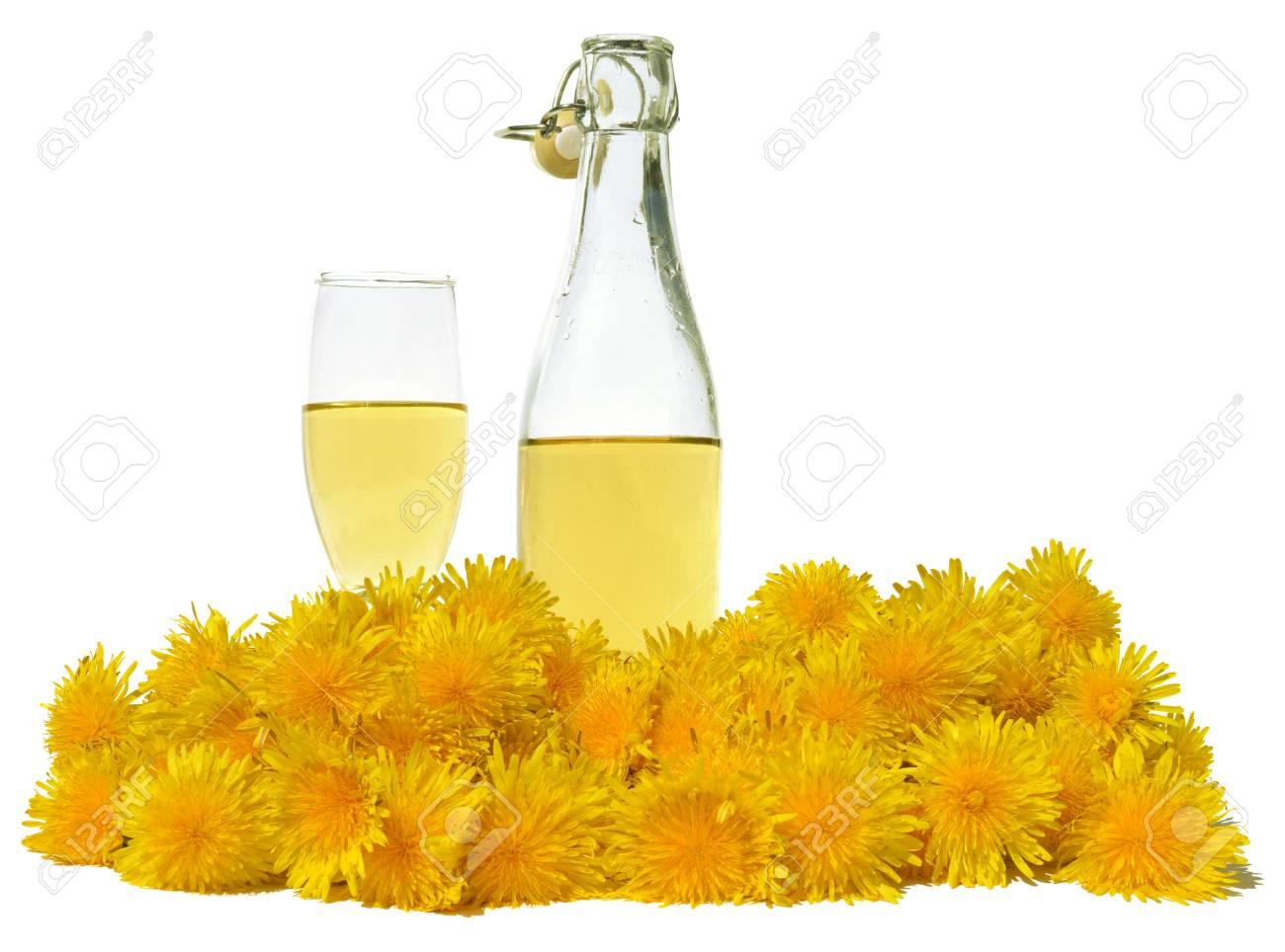 Dandelion Wine in glass and bottle - 39027669