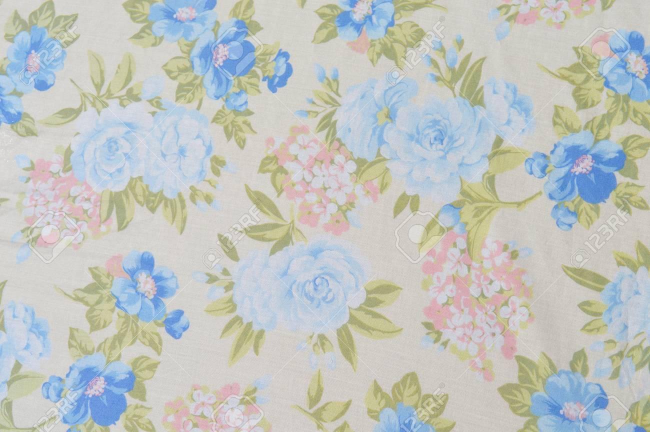 Fond de tissu avec des fleurs pastel