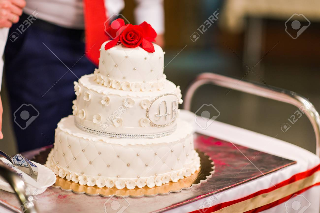 White Wedding Cake With Red Flowers On Top Stock Photo Picture And