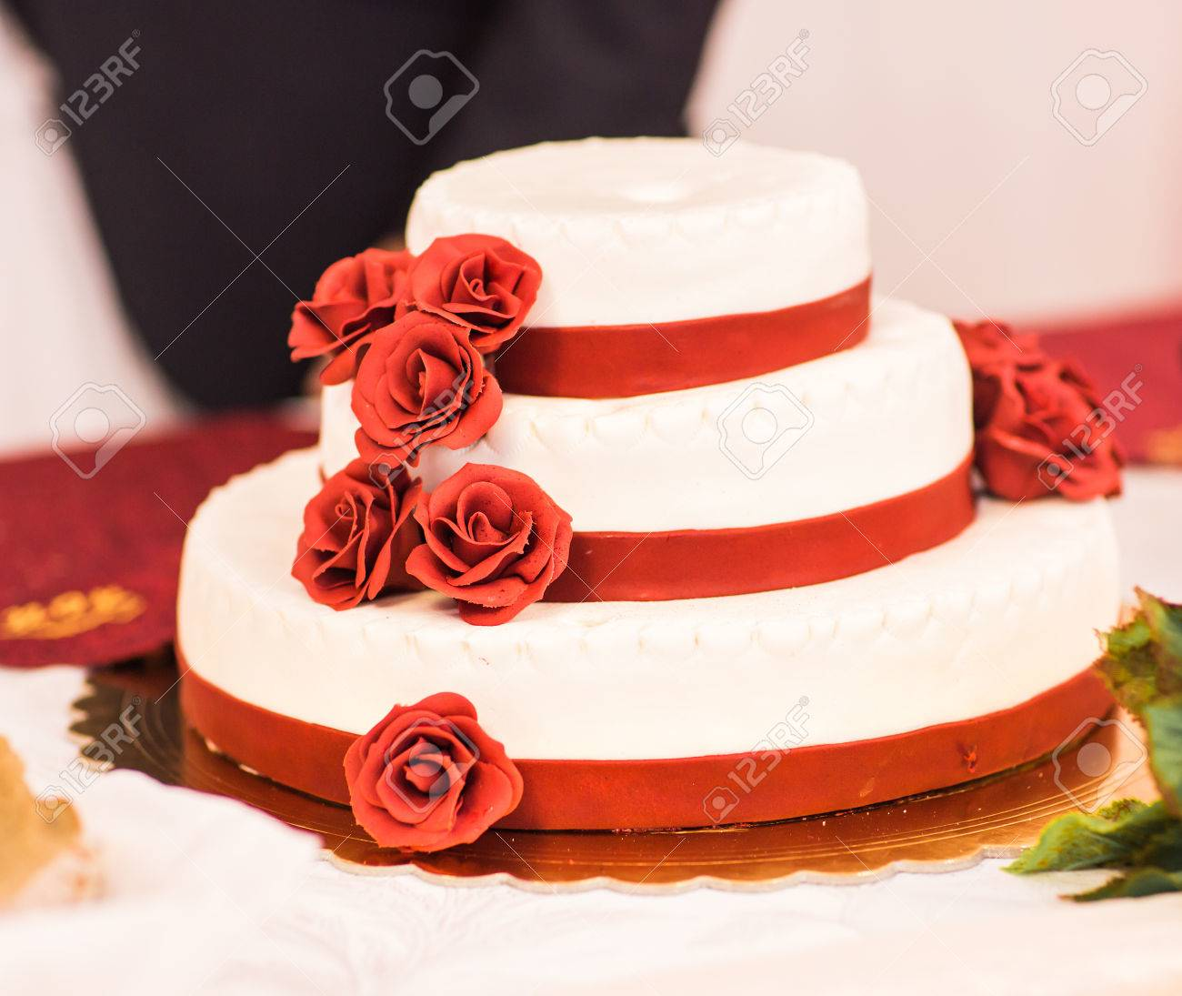 Wedding Cake With Red Roses. Wedding Dessert Stock Photo, Picture ...