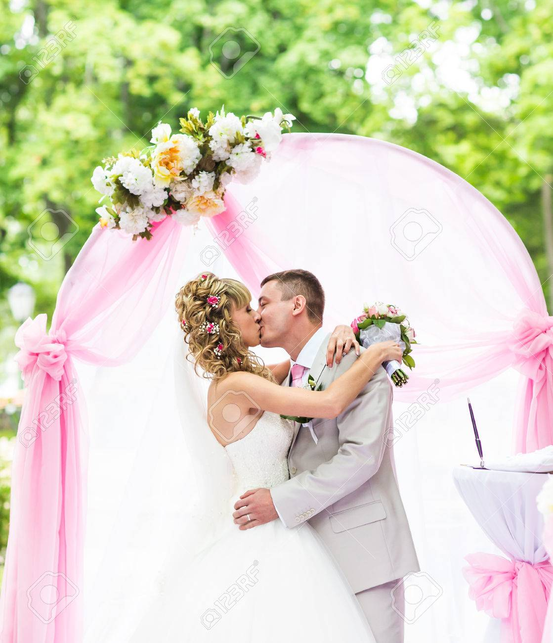 Happy Newlywed Romantic Couple Kissing At Wedding Aisle With.. Stock ...