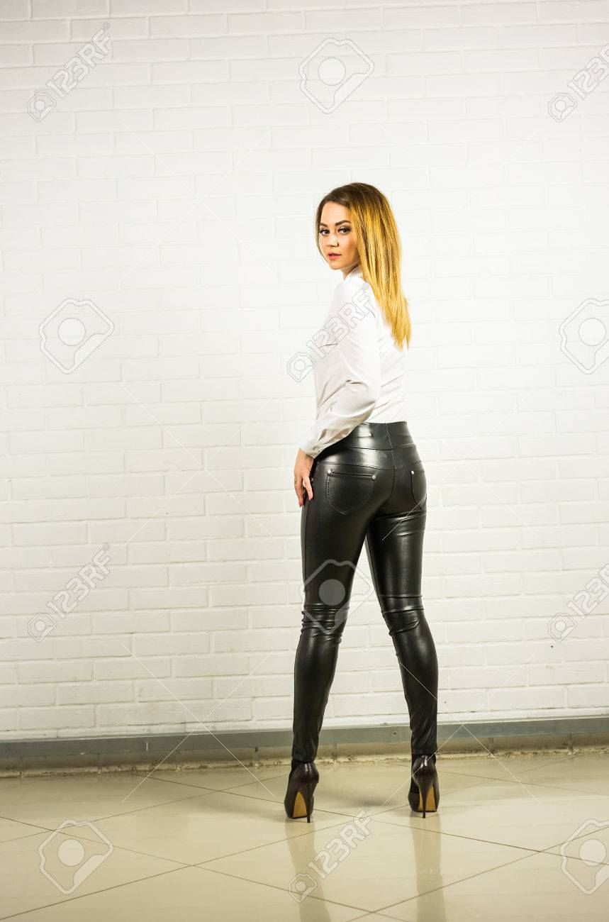 4abb5f2bc1b Woman wearing black leather pants and high heel shoes.
