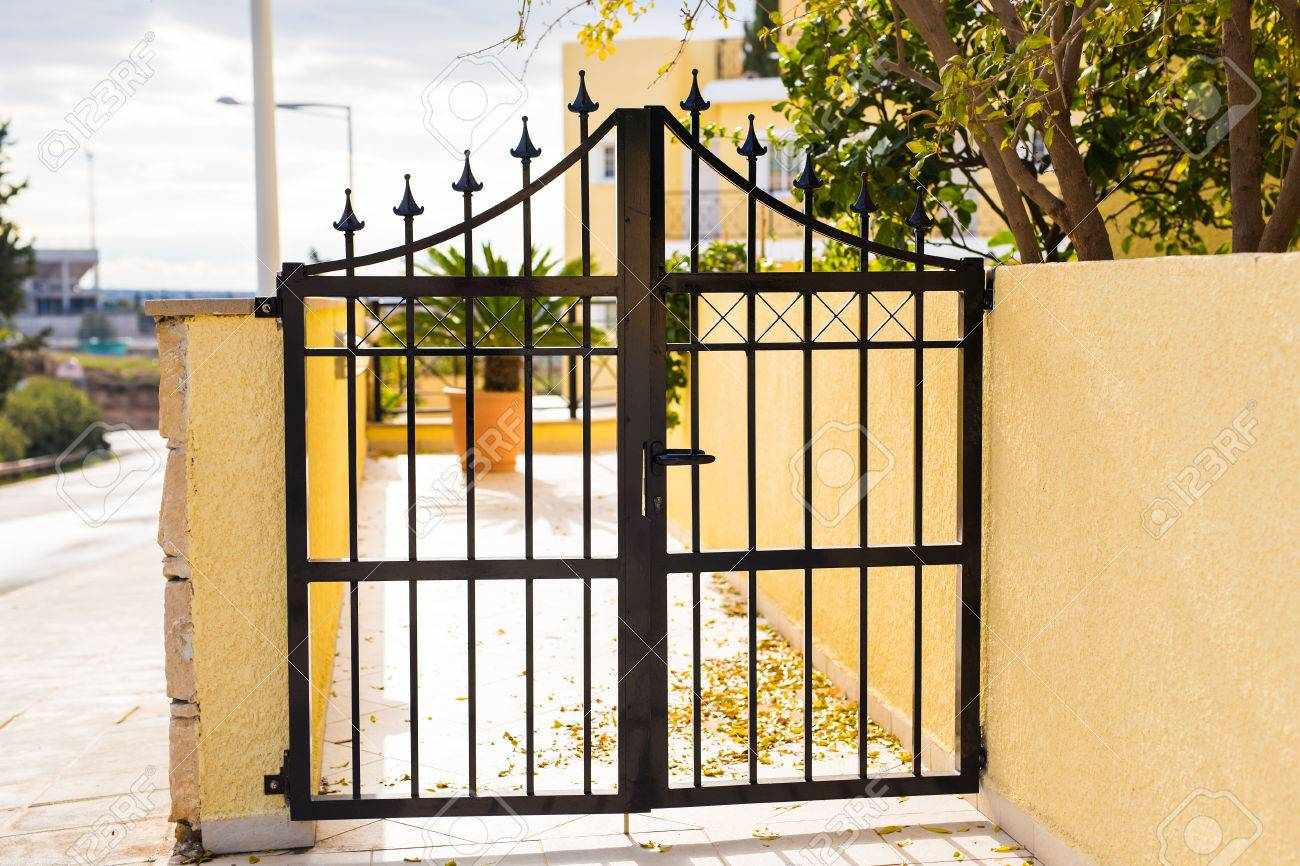 Wrought Iron Gate. Closed Entrance To Private Territory Stock Photo ...
