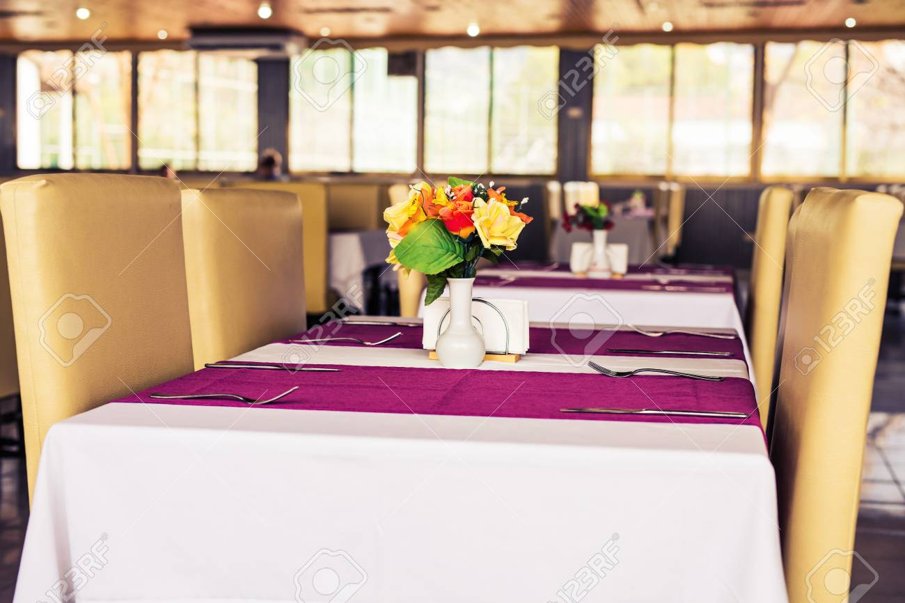 close up elegant tabletop setting design for four people inside an expensive restaurant stock photo