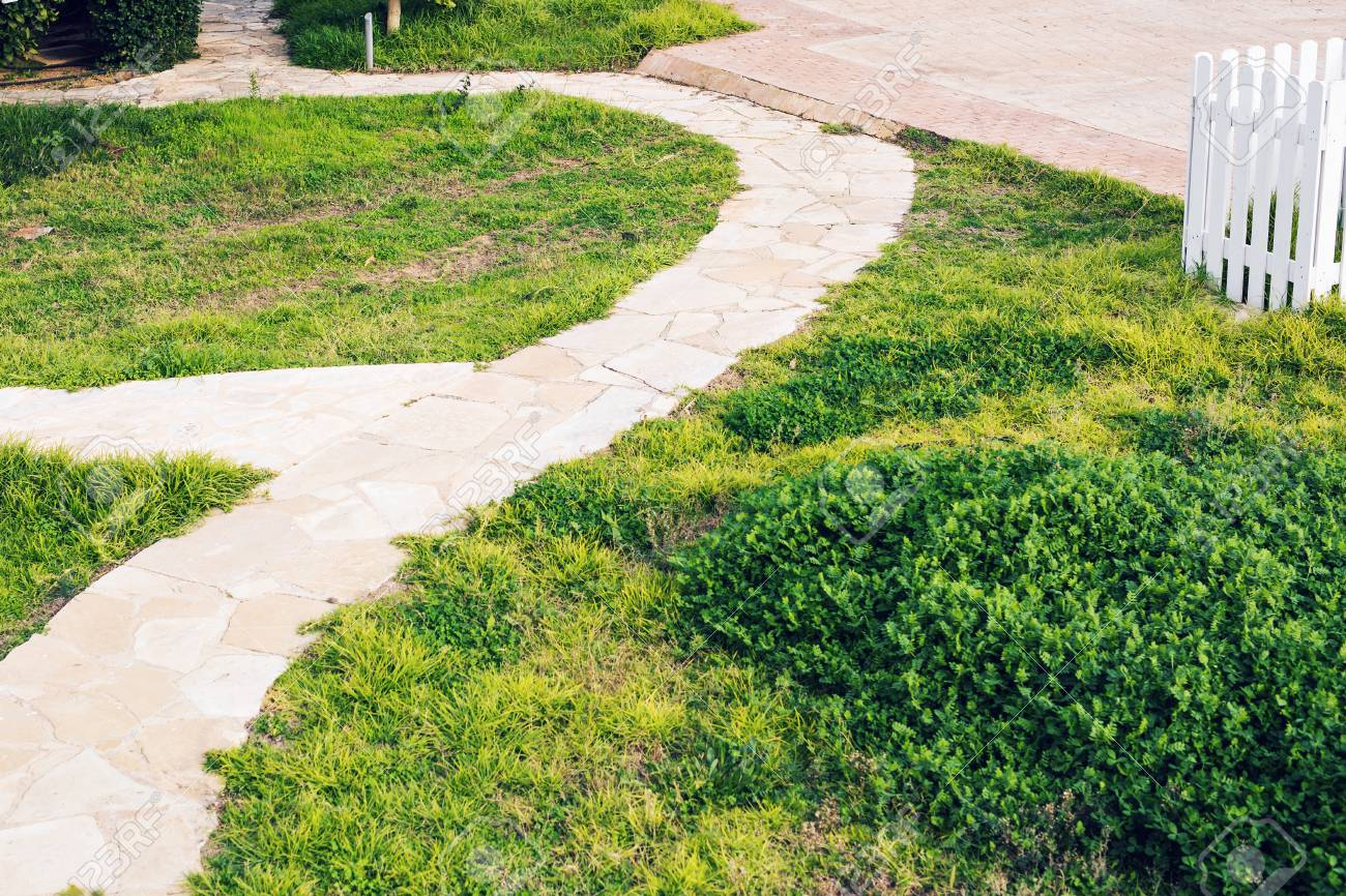 Pathway In Garden Green Lawns With Bricks Pathways Garden Landscape Stock Photo Picture And Royalty Free Image Image 76370711