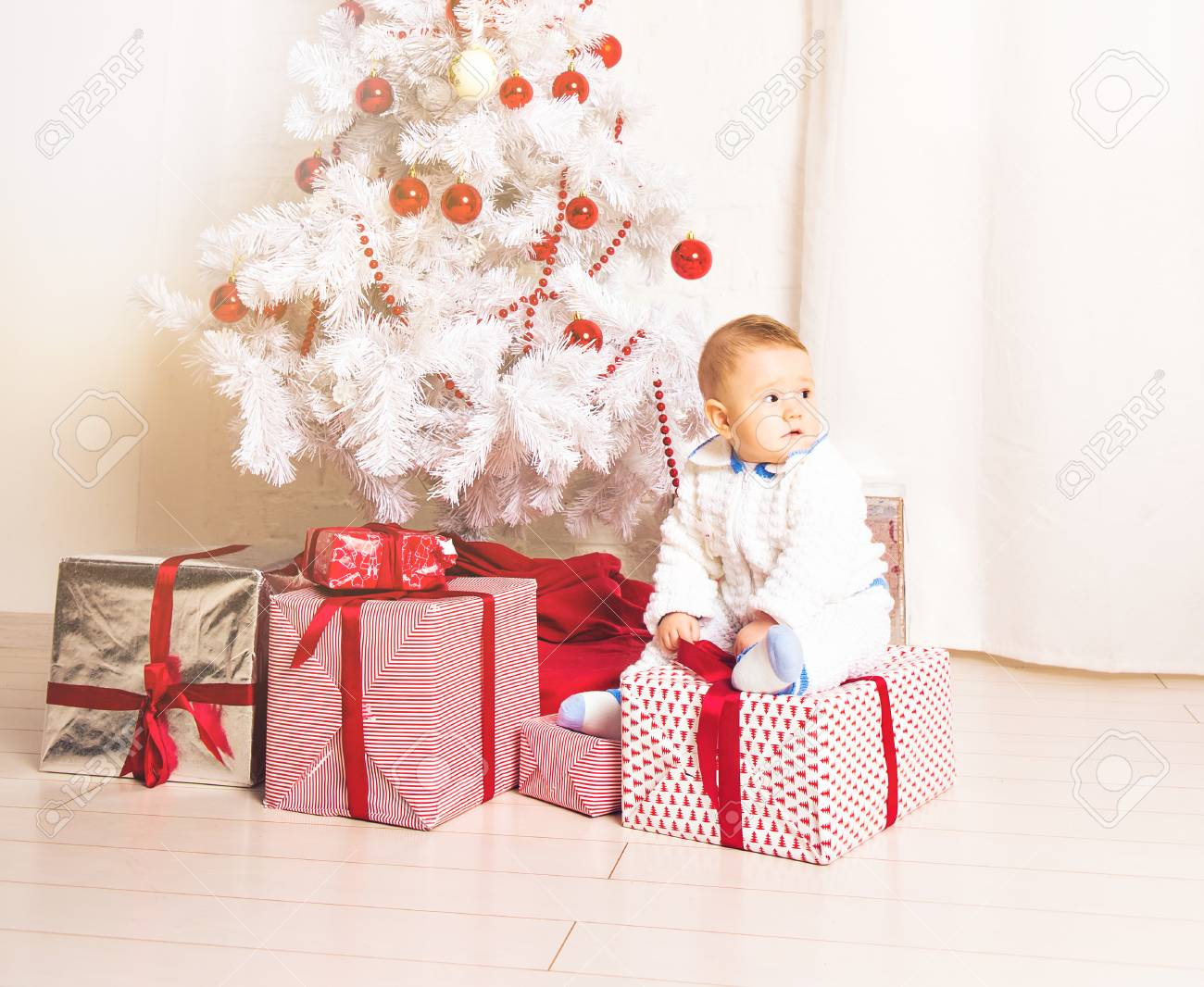 Christmas Crafts For 1 Year Olds.Baby 1 Year Old Sitting On Gift Box With Christmas Tree Merry