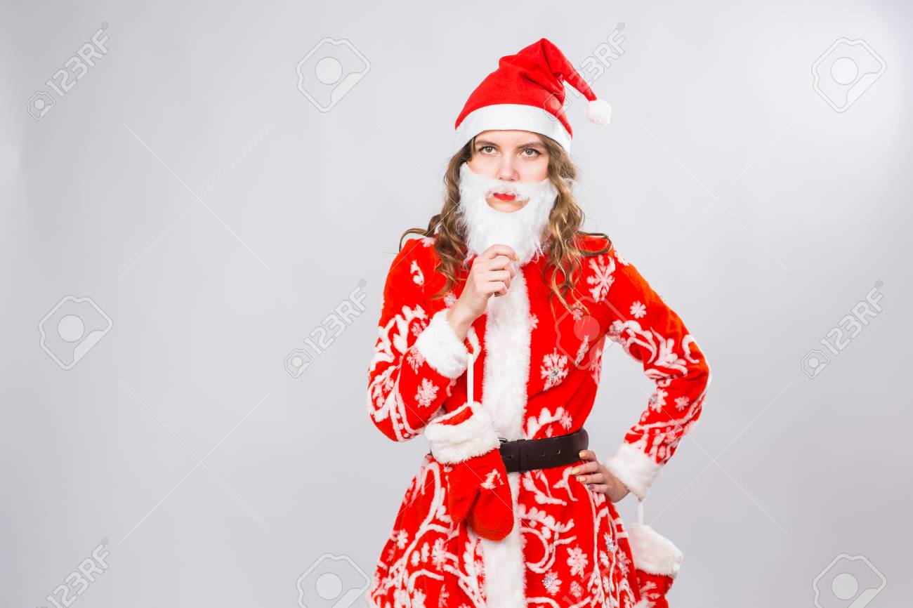 74cb3eddd05 Funny girl in wearing xmas santa costume and beard over white background  with copy space.