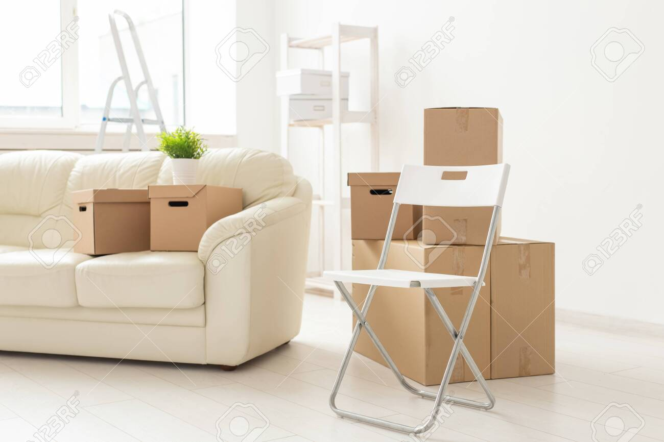 Folding Chair Sofa And Boxes Are In The New Living Room When