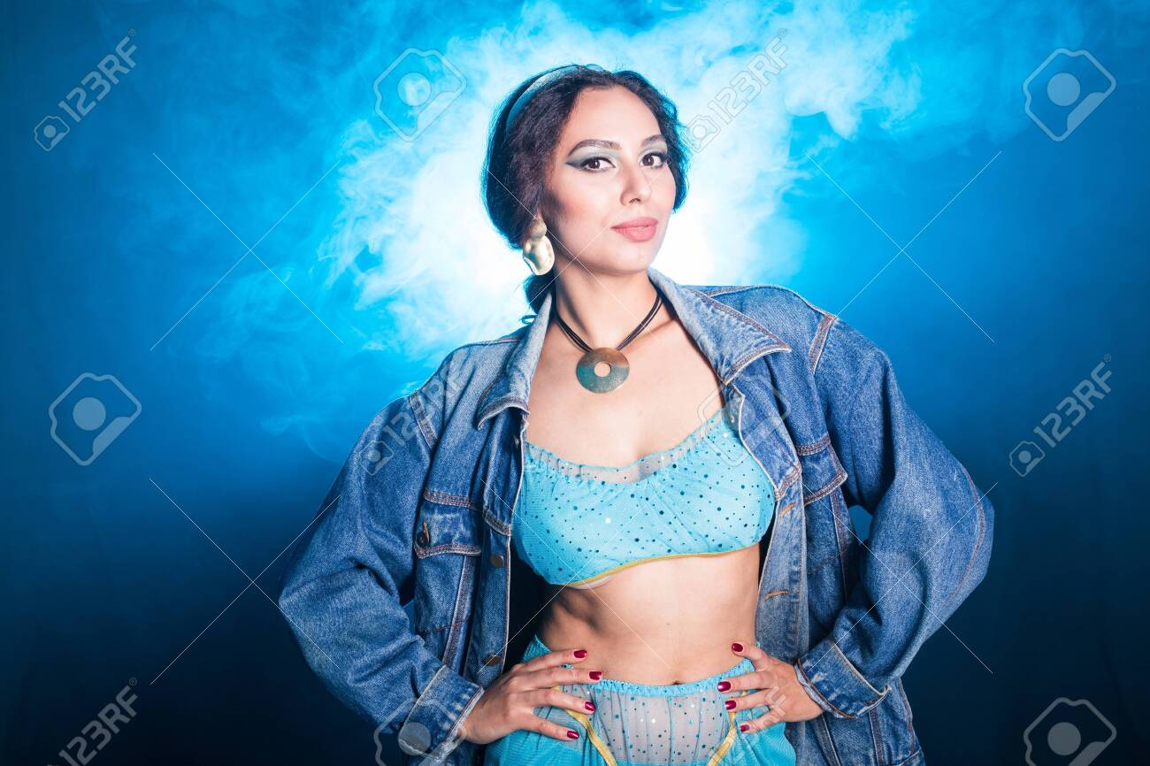 Magic, cosplay and fairy tale concept - Portrait of a young woman in the image of an Eastern fairy Princess on blue background. - 144776175