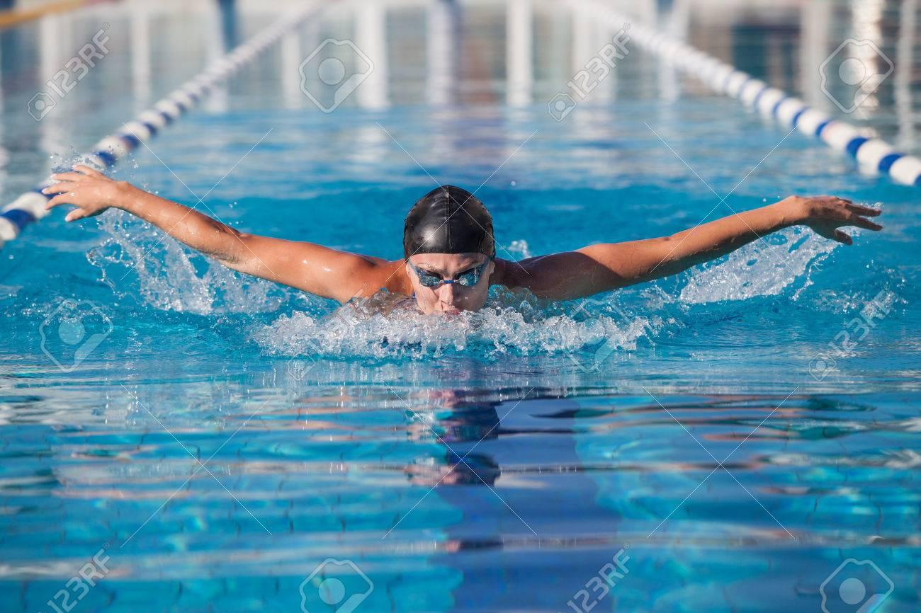 dynamic swimmer in cap glasses in the pool - 37174329