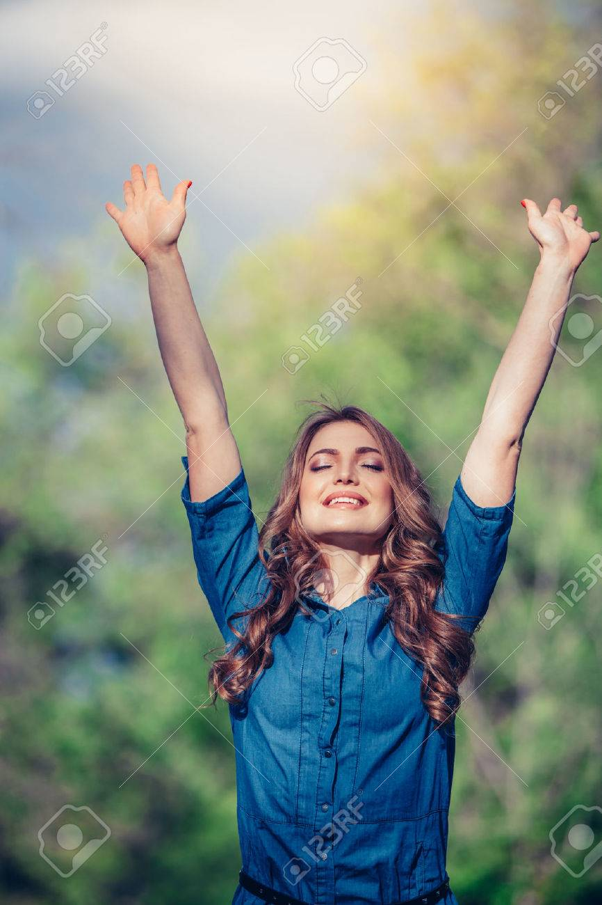 Free Happy Woman Enjoying Nature. Beauty Girl Outdoor. Freedom concept. Beauty Girl over Sky and Sun. Sunbeams. Enjoyment. - 40069427