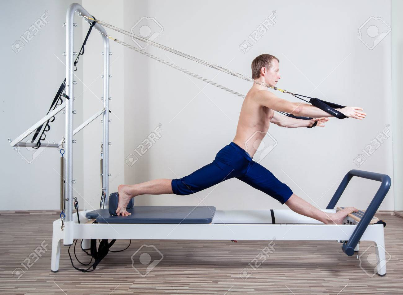 Pilates reformer workout exercises man at gym indoor - 40299167