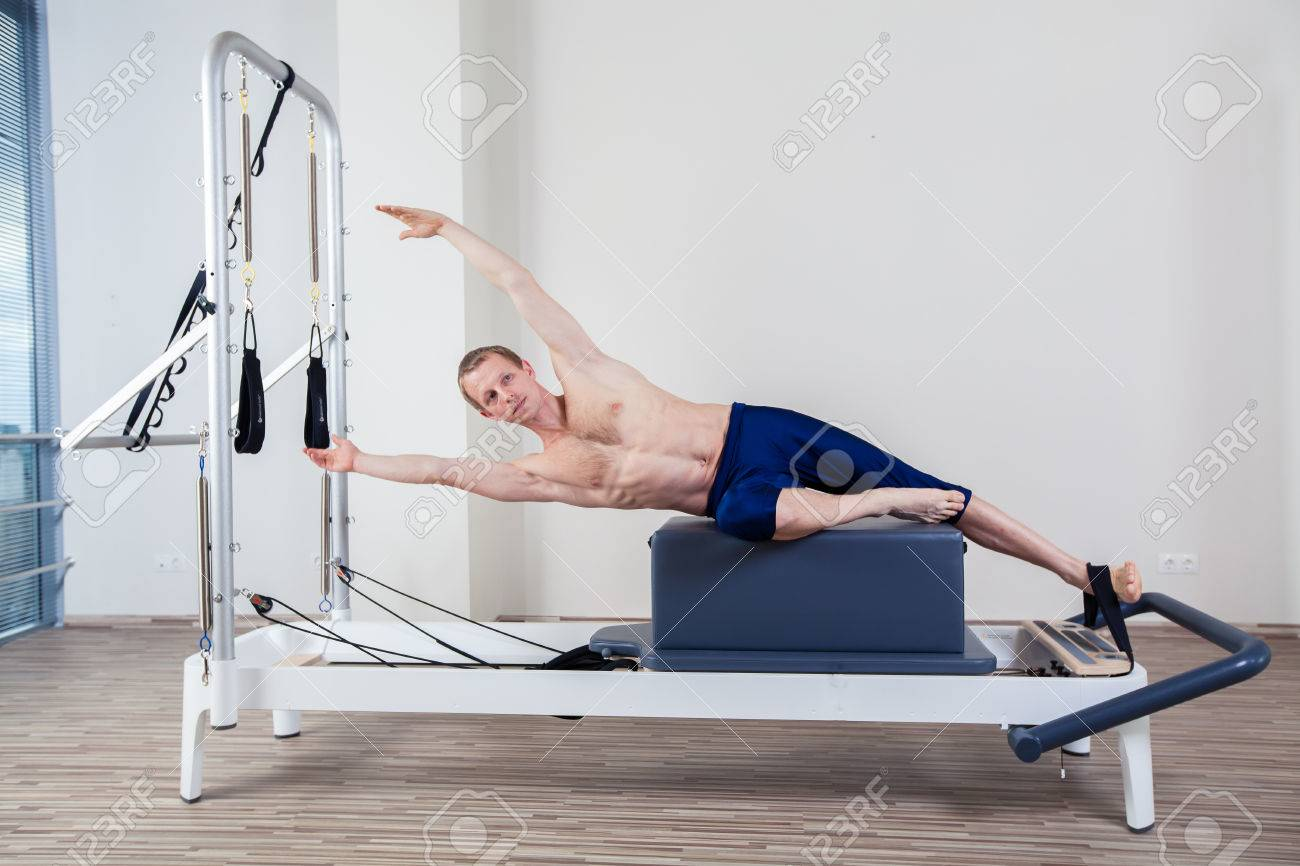 Pilates reformer workout exercises man at gym indoor - 40299522