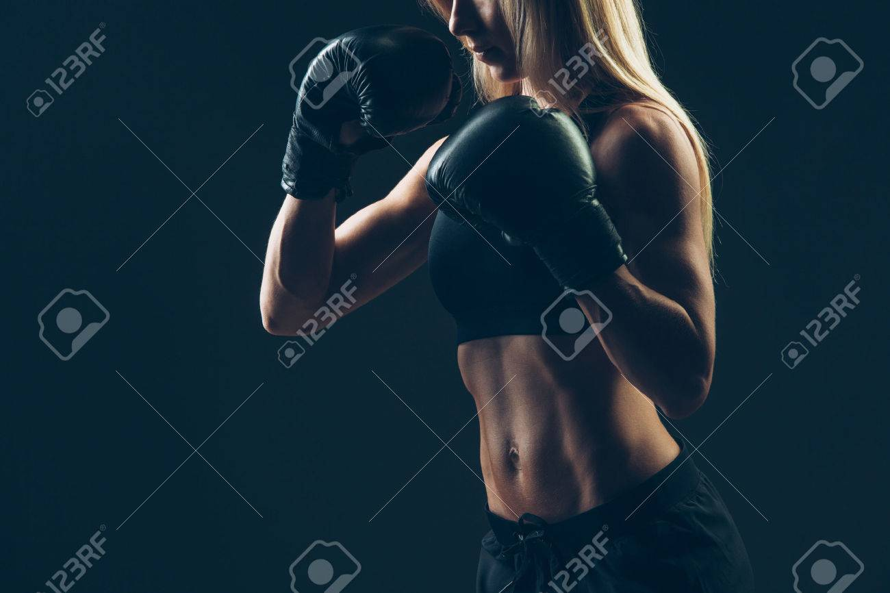 beautiful woman with the red boxing gloves,black background - 43578505
