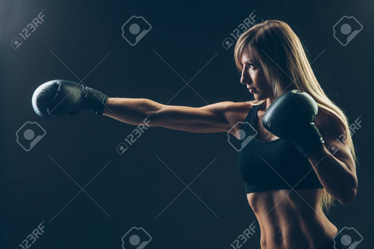 beautiful woman with the red boxing gloves,black background - 43575964