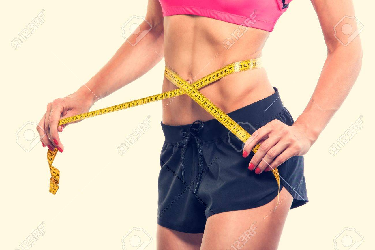 Weight losing - measuring woman's body, isolated centimeter - 43575880
