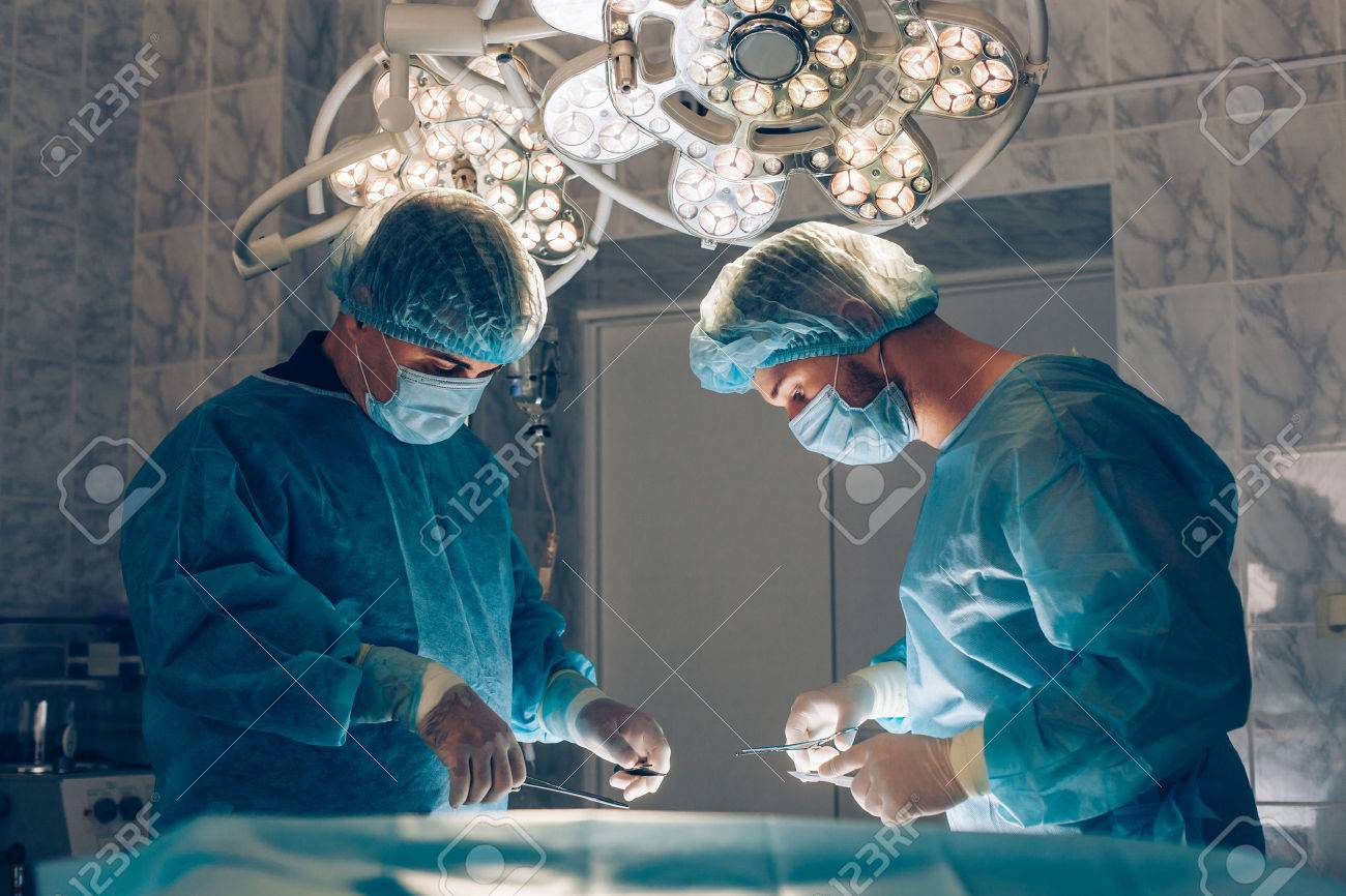Surgeons team working with Monitoring of patient in surgical operating room - 46517073