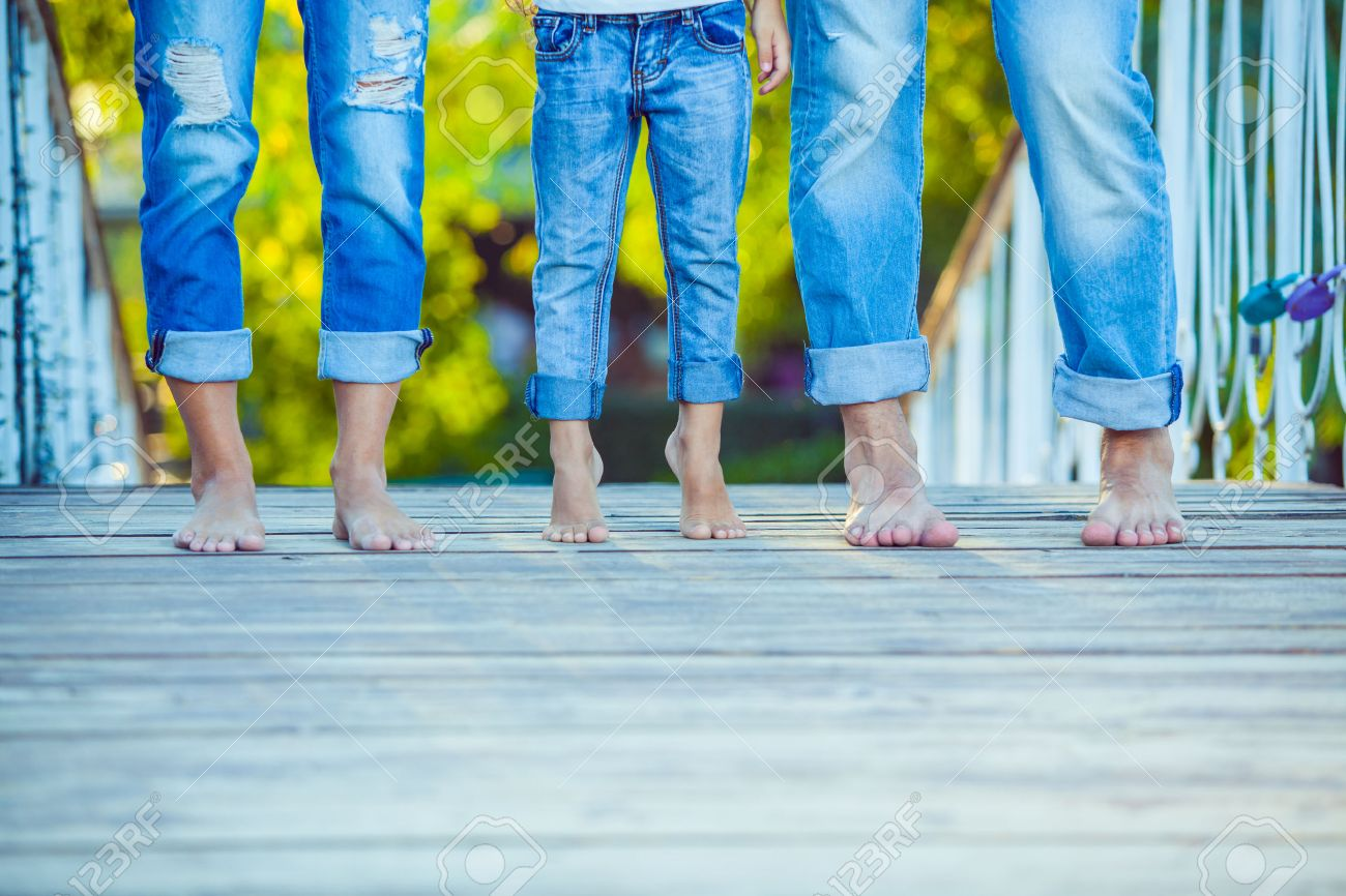 Happy Family on a Walk in Summer. Child with Parents Together. Feet Barefoot . Healthy Lifestyle. Dad Mom and Son. Spring Time. - 47750541
