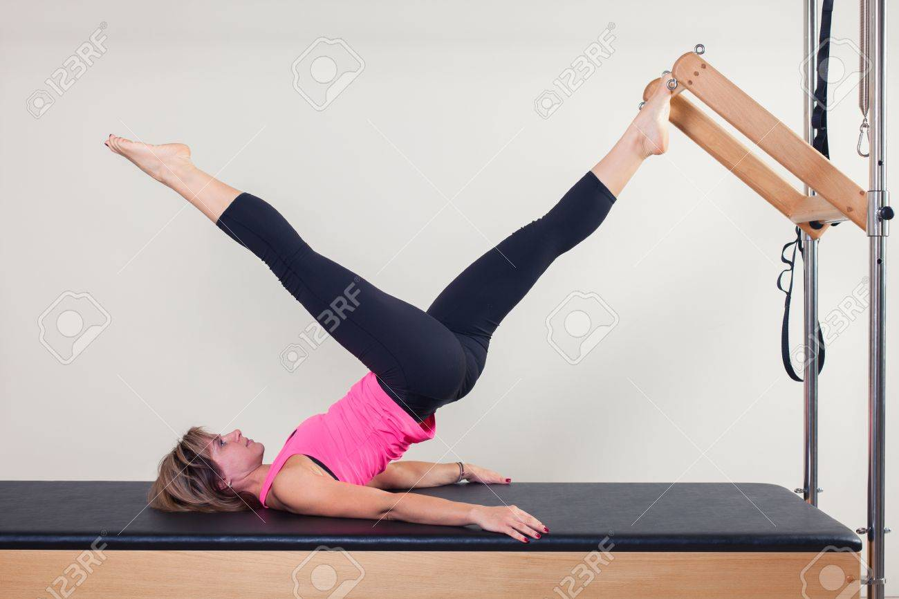 Pilates aerobic instructor woman in cadillac fitness exercise. - 48806258