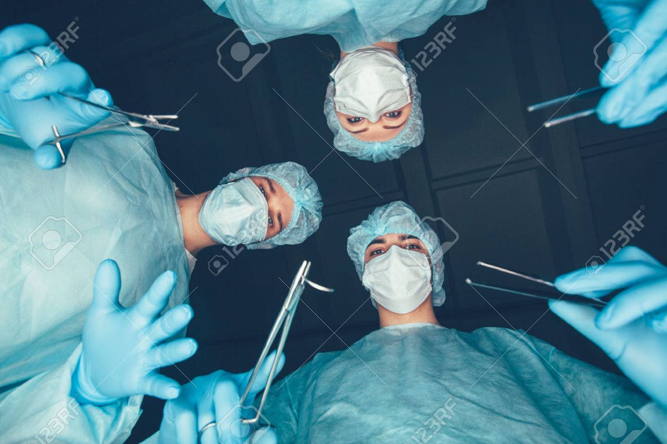 medical team in hospital performing operation group of surgeon