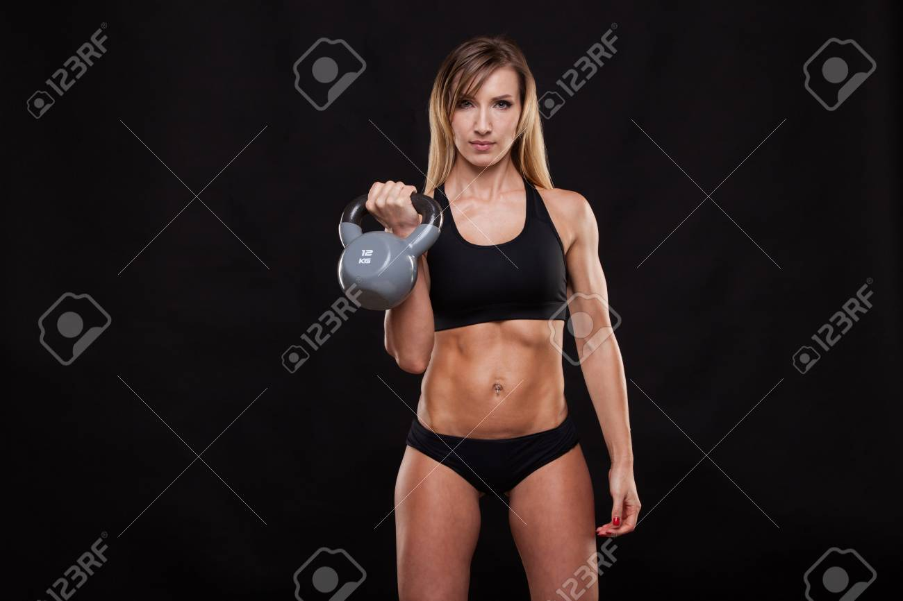 Young Attractive Fitness Woman Is Doing Exercise With A Kettlebell