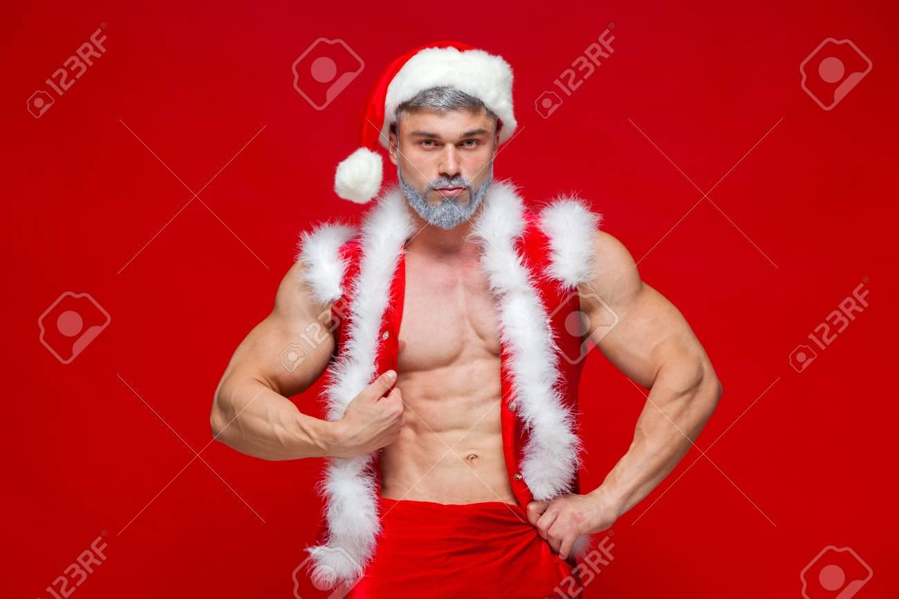 Sexy Santa Claus . Young muscular man wearing Santa Claus