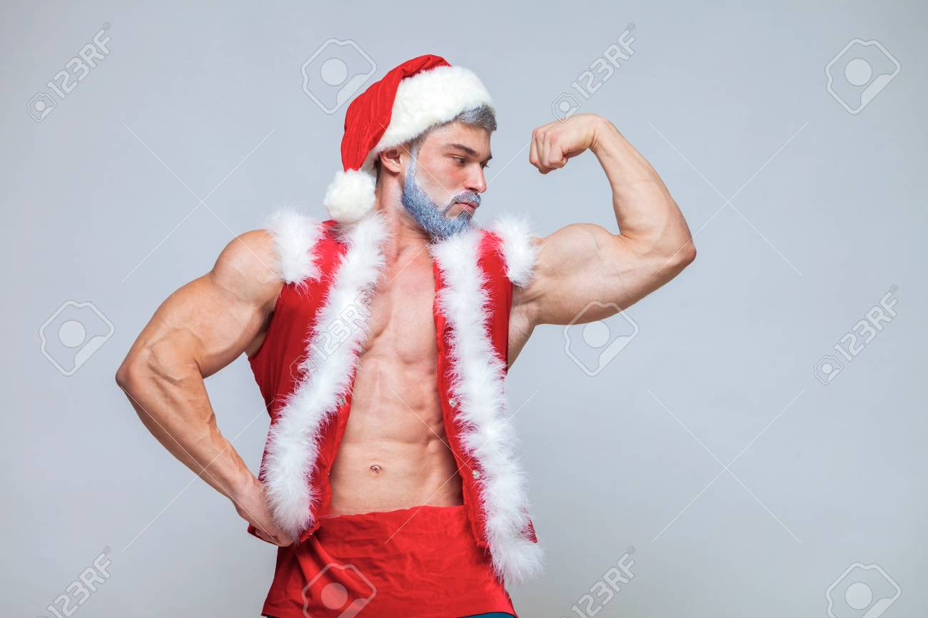 e96026f82774e Christmas. Sexy Santa Claus . Young muscular man wearing Santa C Stock  Photo - 111526786