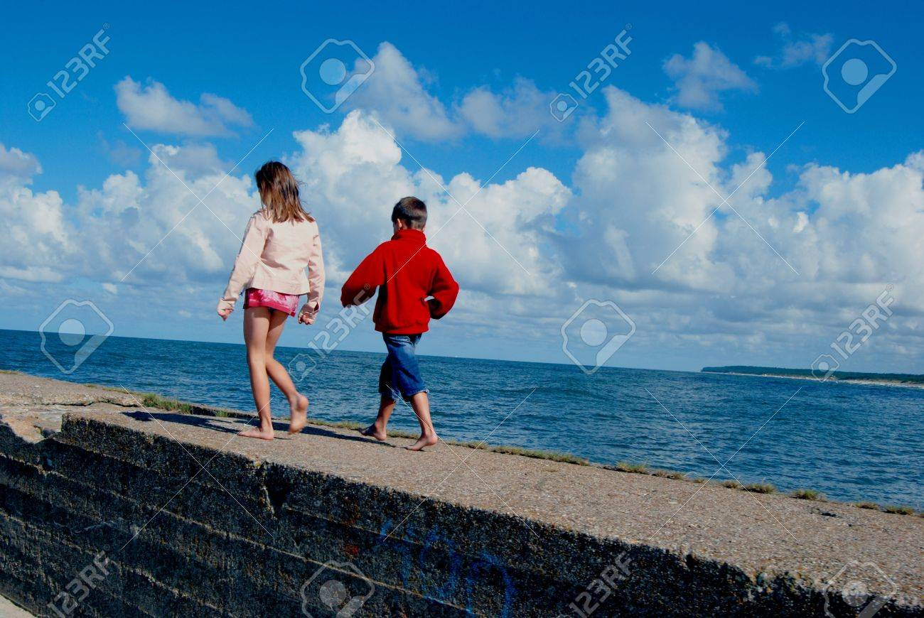 boy and girl playing near the still sea Stock Photo - 8796119