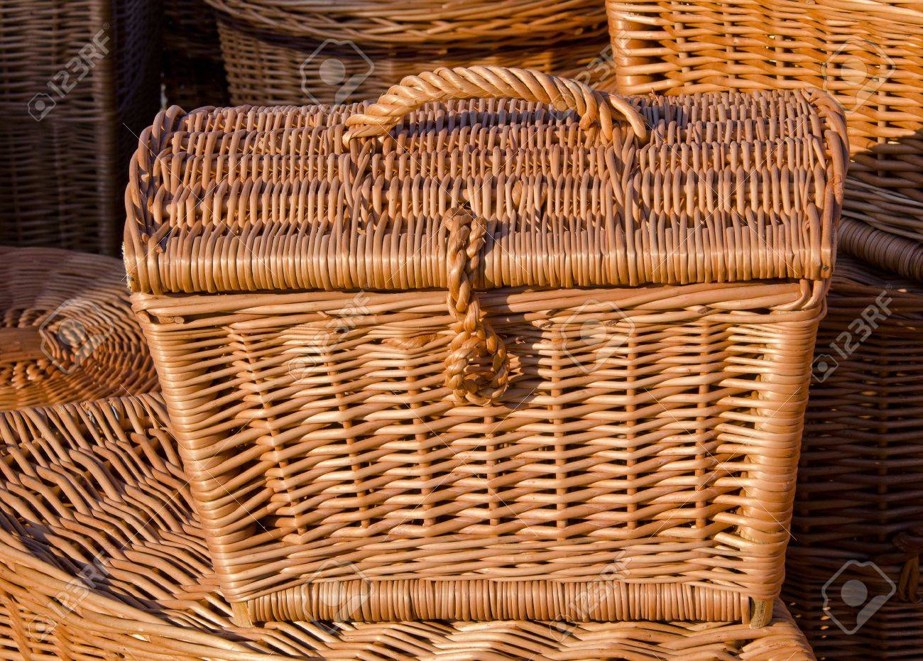 Lots of handmade wooden wicker basket with lid and handle. Stock Photo -  10612215
