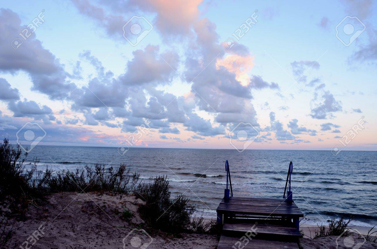 Stairs in dunes and sea view. Natural sea and cloudy sky background. Stock Photo - 11567212