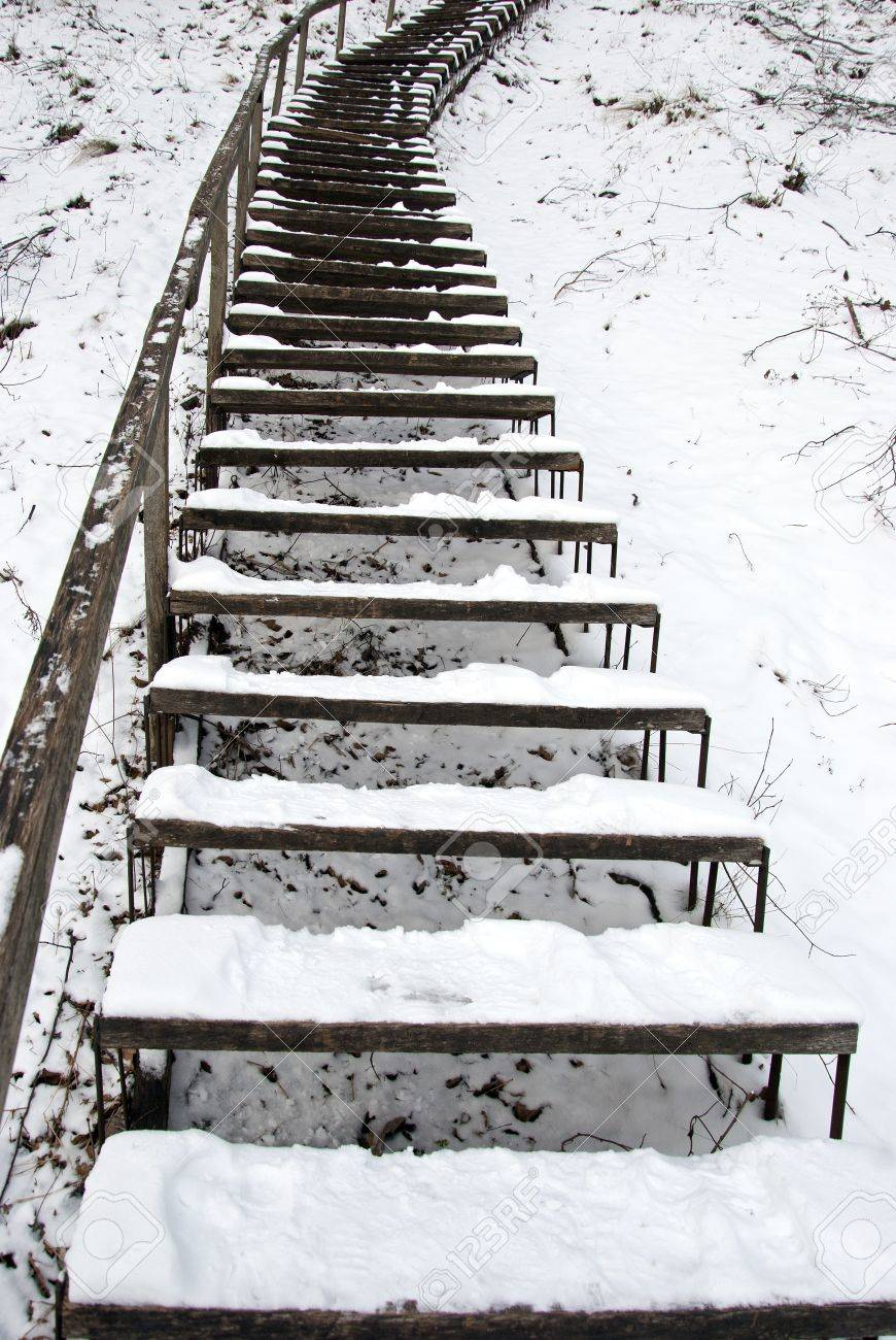 Stairs covered with snow leading to a steep hill in winter. Stock Photo - 12030019