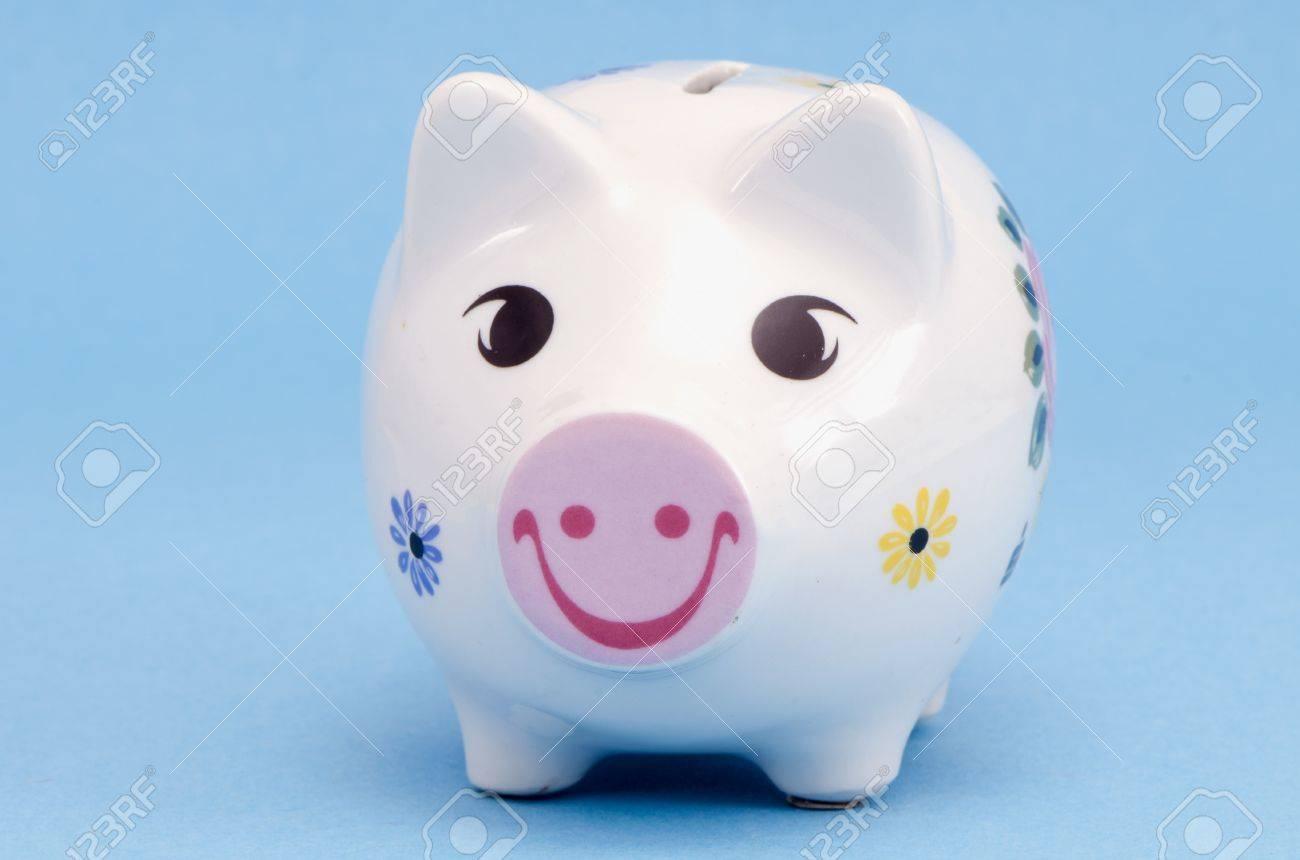 Isolated white ceramic piggy box money-box with smiles and flowers decors on white background  Saving money for black day  Nest-egg Stock Photo - 13159325