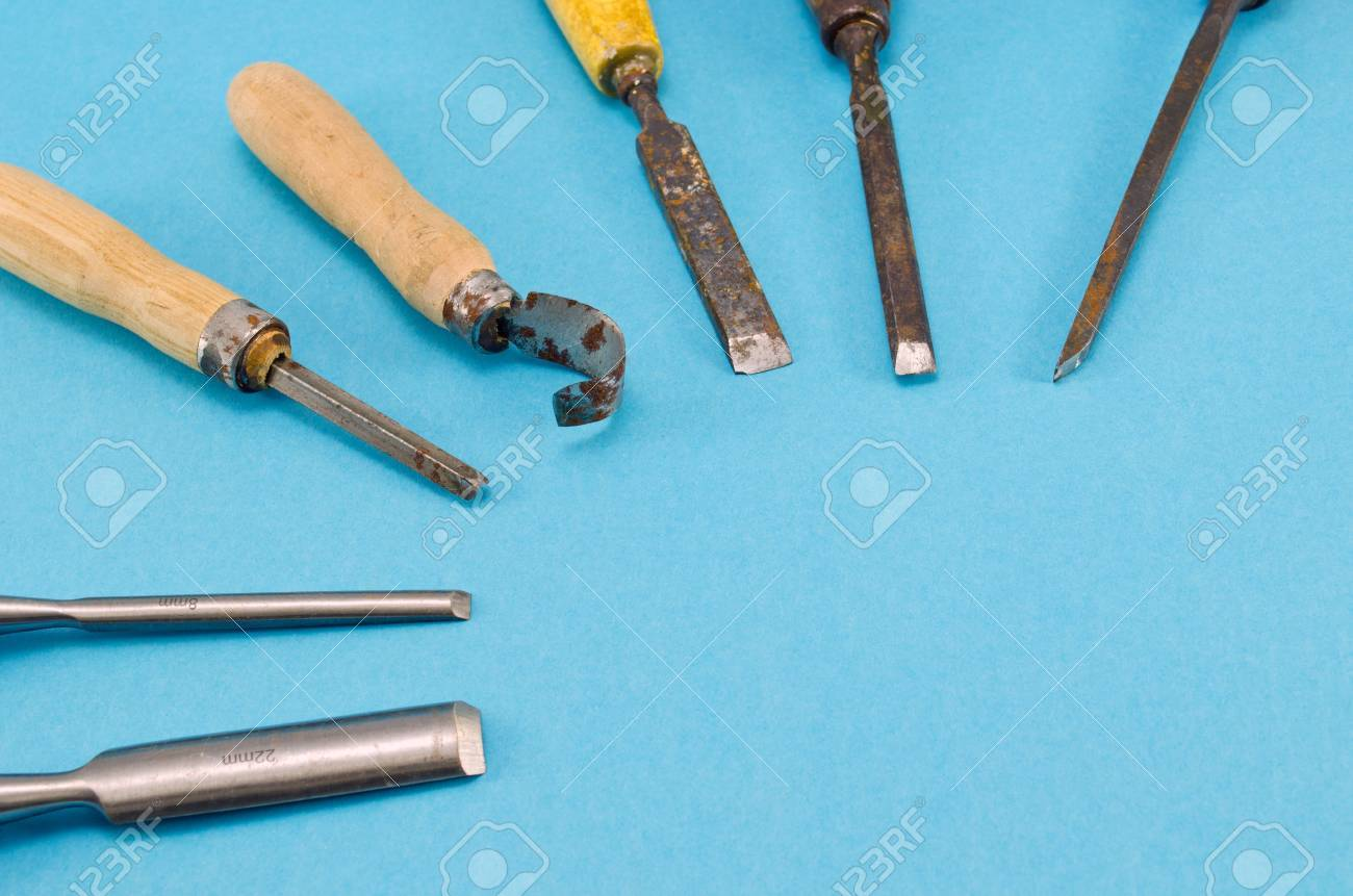 chisel graver carve tools collection for wood work on blue background. place for text. Stock Photo - 16158026
