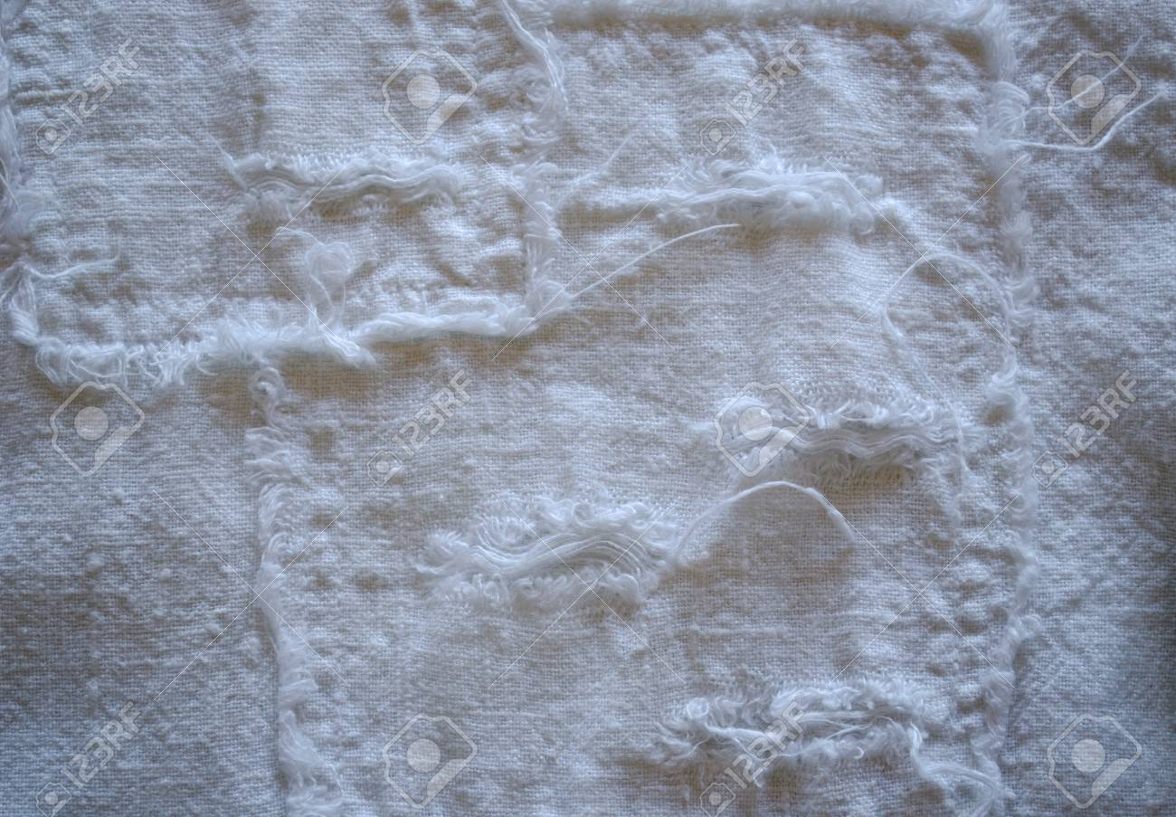 linen pant fabric closeup with long messy thread twist background Stock Photo - 18782425